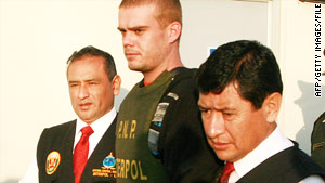 Joran van der Sloot, center, is escorted by police in Tacna, Peru, on June 4.