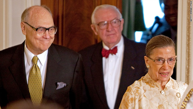 Martin Ginsburg, left, escorts his wife, Justice Ruth Bader Ginsburg, to a reception in 2009.