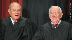 Justice John Paul Stevens, right, poses with Justice Anthony Kennedy in September.