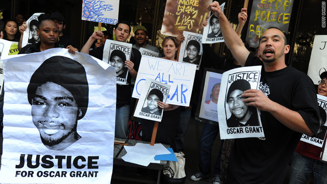 Oakland residents demand justice at a March rally honoring Oscar Grant.