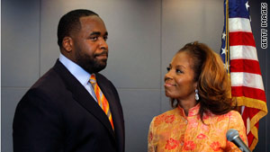 Former Detroit Mayor Kwame Kilpatrick and wife, Carlita, appear before the press in September 2008.