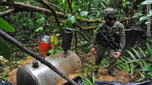 A Colombian soldier looks over part of a cocaine-making operation run by the rebel group FARC.