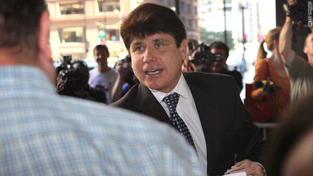 Illinois ex-Gov. Rod Blagojevich greets people as he arrives for his corruption trial last month.