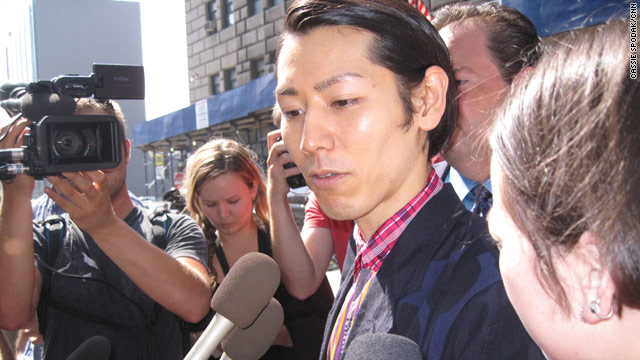 Competititive eating champion Takeru Kobayashi leaves a New York courthouse after a hearing Thursday.
