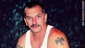 John Charles McCluskey, 45, seen here in 2005, is described as armed and dangerous.