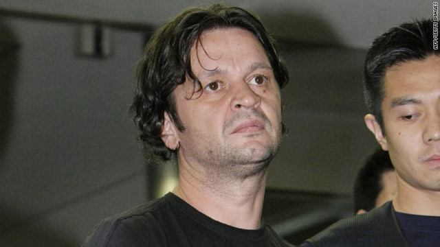 Montenegrin Rifat Hadziahmetovic, 42, an alleged member of the 'Pink Panther' gang of international jewel thieves, arrives at the Narita International Airport in Japan August 14.