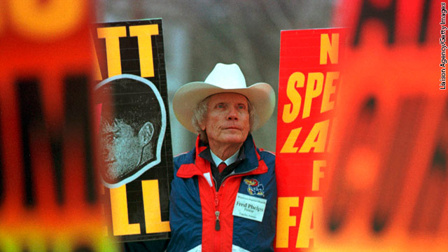 "Church members, led by pastor Fred Phelps, believe God is punishing the United States for ""the sin of homosexuality."""