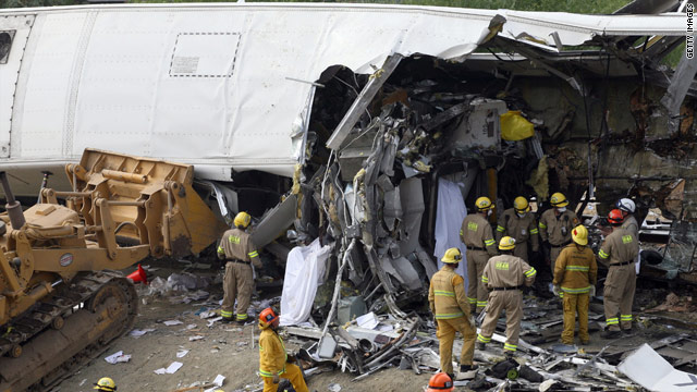 Firefighters survey the wreckage of a September 2008 train collision in California that killed 25 people.