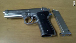 Police say Shanna Spalding, 28, of Queens, used this gun. She faces robbery and weapons charges.