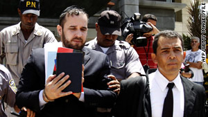 Jorge Torres-Puello, left, here outside a Santo Domingo, Dominican Republic, court in April, faces charges in the U.S.