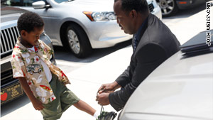 Former teacher Randolph Forde brings his son to a job fair in an effort to get his old job back.