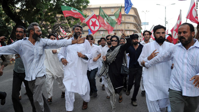 Fowzia Siddiqui, center, the sister of Aafia Siddiqui, leads a rally against the United States on Friday in Karachi, Pakistan.