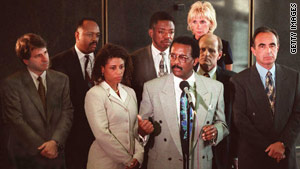 "Holley, center left, worked with Johnnie Cochran on O.J. Simpson's ""dream team."" Simpson was acquitted."