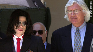 Tom Mesereau walks into court with his most famous client, Michael Jackson, the late King of Pop.