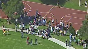 Two students, ages 6 and 7, were shot and suffered minor injuries at a Carlsbad, California, school, said police.