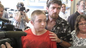 Cameras surround the teen, with his dad, Michael Sr., as he enters his birthday party at a Florida senior citizens center.