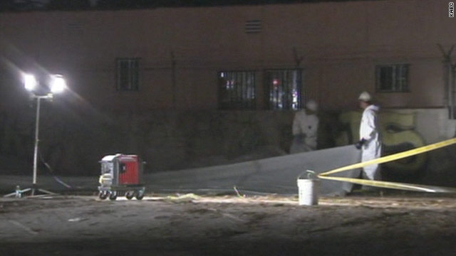 Workers inspect the scene in Southern California where a man was electrocuted.