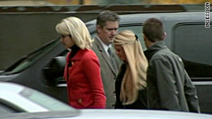 Elizabeth Smart, left, arrives for court Monday in Salt Lake City, Utah. She is scheduled to testify this week.