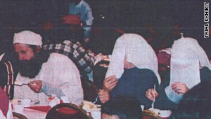 Brian David Mitchell eating Christmas dinner in San Diego in 2002. Elizabeth Smart is on the far right.