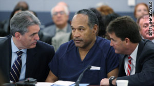 Attorneys Gabriel Grasso, left, and Yale Galanter talk with O.J. Simpson at his sentencing in December 2008.