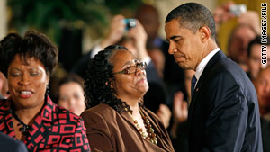 President Obama greets James Byrd Jr.'s family after remarks on the enactment of the 2009 Hate Crimes Prevention Act.