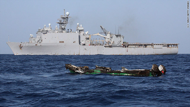 A burned-out pirate skiff sits near the USS Ashland in the Gulf of Aden on April 10.