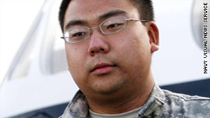 Navy Reserve Intelligence Specialist 3rd Class Bryan Minkyu Martin was taken into custody Wednesday on suspicion of selling classified information.