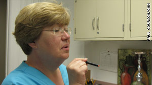 Nurse Barbara Kilgalen demonstrates an e-cigarette during research at Virginia Commonwealth University.