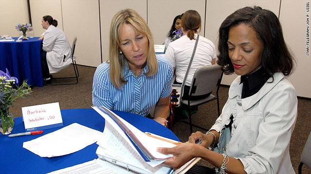 Dr. Barbara Webster, left, talks with patient Mona Myers at a Doc Shop session.