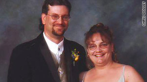 Chris Dolley and her husband, shown at a sister-in-law's wedding in 2004.