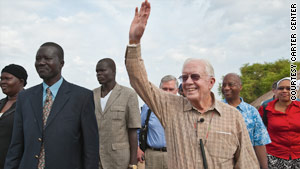 Makoy Samuel Yibi  Logora accompanies former President Jimmy Carter in southern Sudan in February 2010.