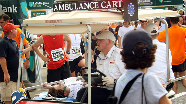 A runner is transported to an aid station near the finish of the 2007 LaSalle Bank Chicago Marathon.
