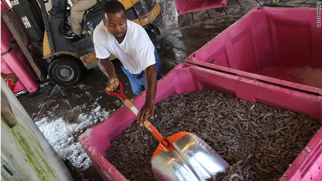Stanley Johnson packs fresh shrimp for shipping May 18 in Port Sulfur, Louisiana.