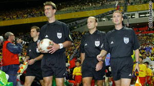 Brian Hall, center, the last U.S. referee to oversee a World Cup game walked to the field in 2002 in Saitama, Japan.