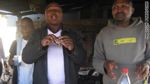 Dumile Klaas and Zandise Mtzang enjoy an afternoon snack in Gugulethu, near Cape Town.