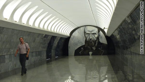 A large portrait of Fyodor Dostoevsky watches subway passengers in Moscow.