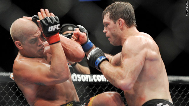 Tito Ortiz and Forrest Griffin battle in a 2009 fight.  The sport has attracted attention again after a martial arts fighter died in June.
