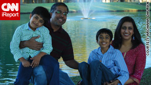 Archana Dhurka, at right, shown with her family, said raising Ankush, 10, also at right, is challenging and rewarding.