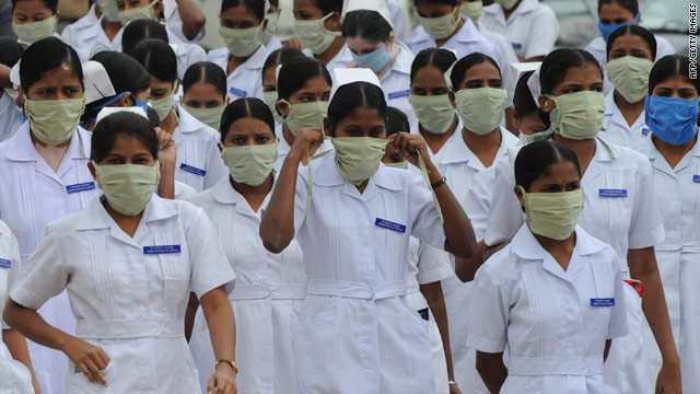 Indian nursing students wear masks at the Government Gandhi Hospital in Hyderabad last week.