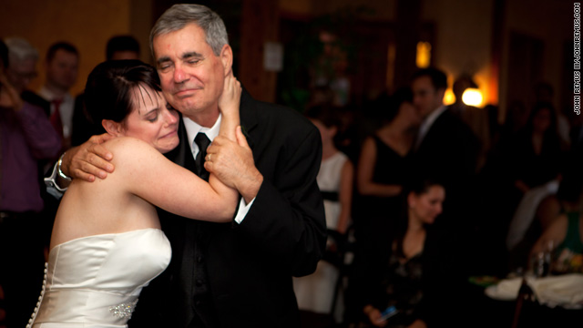 Steve Holl , who's receiving an experimental vaccine to fight a brain tumor, danced at his daughter Eryn's wedding last month.