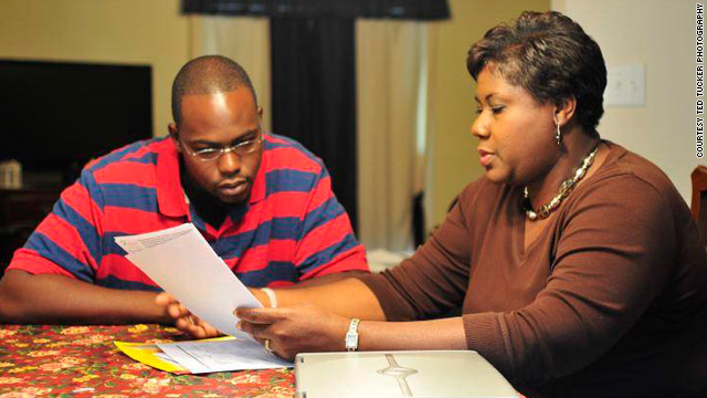 Joshua and Delores Armstrong look at a hospital bill together. A $10,000 emergency room charge shocked the family.