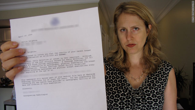 Hallie Leighton holds up the letter from her doctor that led her to believe that she did not have breast cancer.
