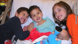 Matthew Lacek in the center, in the company of his siblings, recovered from his infection with Hib in 2006.