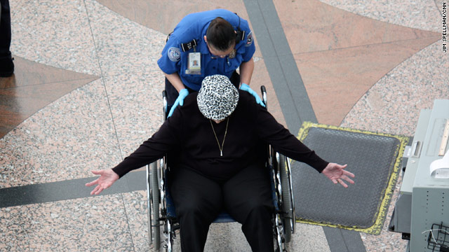 A traveler undergoes a pat down at Denver's main airport. Doctors say they hope the TSA takes into account medical conditions.