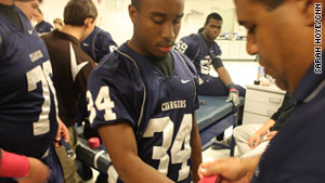 Marc Cephas, a New Jersey high school football player, gets ready for a game.  He and other student athletes will be closely watched for head injuries under the new state law.
