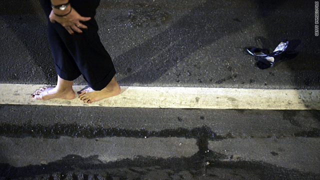 A woman walks the line during a field sobriety test in 2006 at a DUI checkpoint in Miami, Florida.