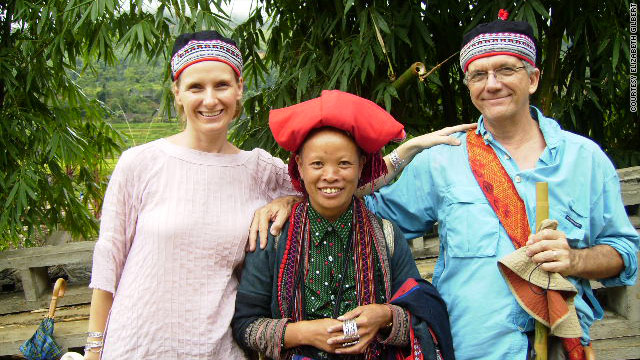 Elizabeth Gilbert, left, and her husband, Felipe, pose with a woman of the Red Zai tribe in north Vietnam.