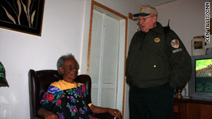 Bobby Stoddard checks on 88-year-old Ida Coleman.