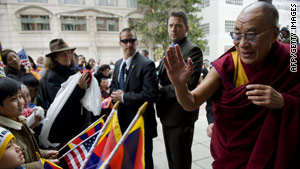 The Dalai Lama greets a crowd celebrating the Tibetan New Year outside a Washington hotel.