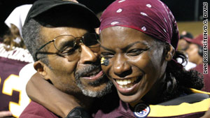 Natalie Randolph shares an embrace with her father, the late Nate Randolph, after a D.C. Divas game in 2006.